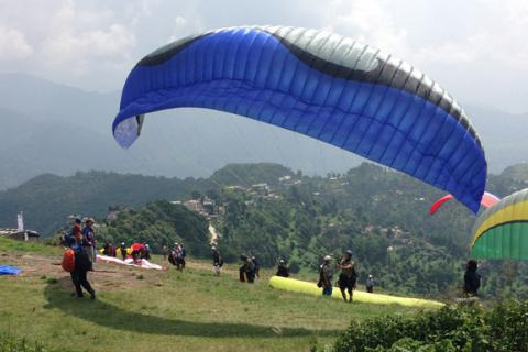Paragliding Trip with River Rafting