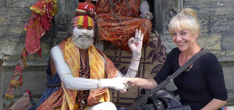 Guest taking photo with sadhu