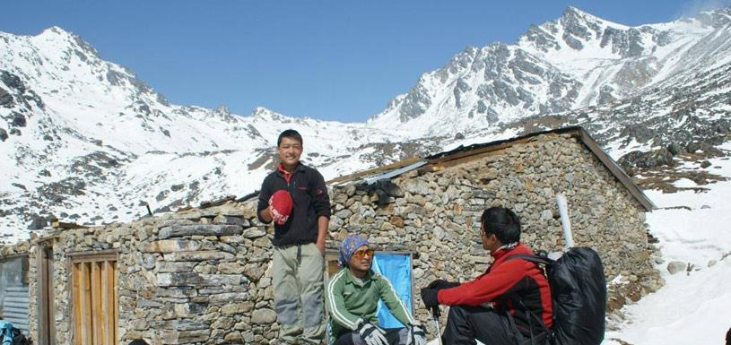 Trekkers resting at the base of Laurebina la Pass (4,610m)