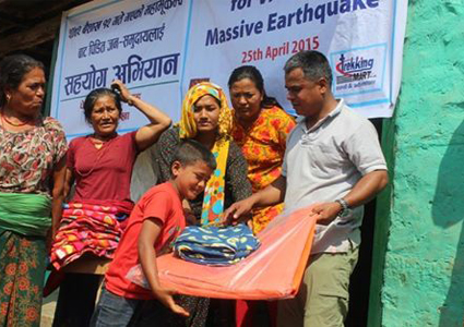 Trekking Mart leader distributing relief materials